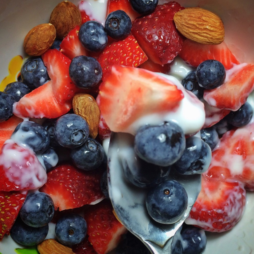 strawberries, blueberries, yogurt and almonds
