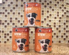 Stacked cans of Dave's Stewlicous Chicken Pot Pie Grain-Free dog food